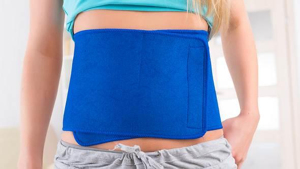 Bauchweggürtel an einer Frau  - Foto: iStock/humonia