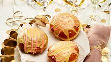 Diese goldigen Berliner Pfannkuchen verbergen eine fruchtige Überraschung. - Foto: House of Food / Bauer Food Experts KG
