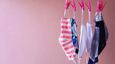 Mundschutz an einer Wäscheleine - Foto: iStock/Yuttachai Saechan