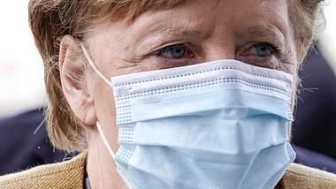 Angela Merkel will den Bundes-Lockdown umsetzen. - Foto: IMAGO / Political-Moments
