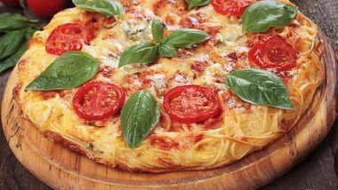 Soul Food pur ist diese Kombination aus Pizza und Pasta. - Foto: iStock/IgorDutina